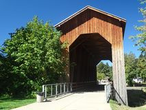 Covered bridge and bike path royalty free stock photography