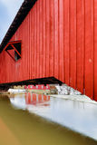 Covered Bridge at Bridgeton. Indiana's Bridgeton Covered Bridge is view up close from one end with the historic mill partially viable in the background Stock Photo