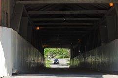 Covered bridge - car and horse cariage Stock Image