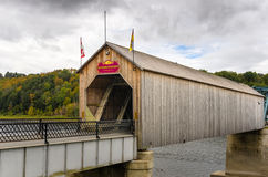 Covered Bridge on a Cloudy Autumn Day Royalty Free Stock Image