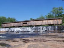 Covered Bridge and Falls Royalty Free Stock Photography