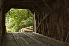 Covered bridge inside. Inside of an old covered bridge on a country road stock photo