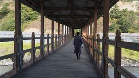 Covered bridge with man walking. Thimpu. Kingdom of Bhutan Royalty Free Stock Photo