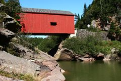 Covered Bridge-NB Canada. This wonderfully-maintained covered bridge hearkens back to a simpler time Stock Photos