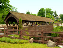 Covered bridge in old forge, ny. Covered bridge over the fulton chain lakes in the tourist town of old forge,ny Royalty Free Stock Image