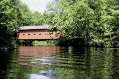 Covered bridge over a lake Royalty Free Stock Photography
