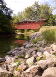 Covered bridge over river Stock Photos