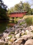 Covered bridge over river Stock Photos