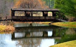 Covered Bridge over River , Hollis, Maine at Sunrise Stock Photo
