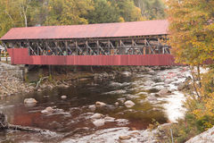 Covered bridge over Saco River in the Crawford Notch state park. Fall colors over water Royalty Free Stock Photography
