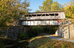 Covered bridge over a stream Stock Photography