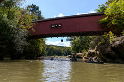 Covered bridge over sugar creek. A covered bridge spans sugar creek in marshall indiana, home of turkey run state park, where people fish, canoe, swim, hike and Royalty Free Stock Images