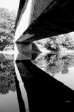 Covered Bridge Reflecting. On water in Southern Quebec stock images