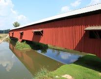Covered bridge reflections. In Bridgeton Indiana Stock Photo