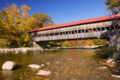 Covered bridge, river and fall foliage, Swift River, NH, USA Stock Photo
