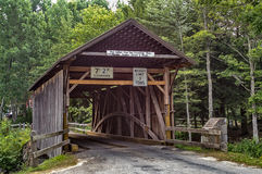 Covered Bridge with Signs Royalty Free Stock Photography