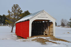 Covered bridge in snow Stock Image