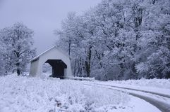 Covered bridge in the snow Stock Image
