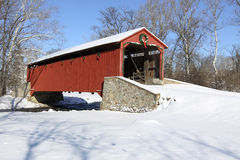 Covered Bridge in Snow. Pool Forge Covered Bridge with snow in Lancaster County, Pennsylvania, USA Royalty Free Stock Photo