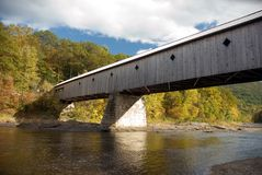 Covered bridge in Vermont. Across a river Stock Photo