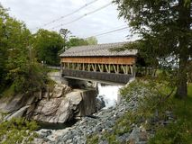Covered bridge with water and rocks or stones in Canada stock photos