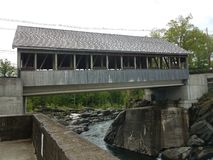 Covered bridge with water and rocks or stones in Canada royalty free stock photo