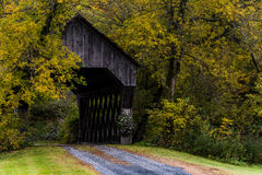 Covered Bridge and Winding Gravel Road - Autumn / Fall - Vermont Royalty Free Stock Images
