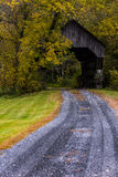 Covered Bridge and Winding Gravel Road - Autumn / Fall - Vermont Royalty Free Stock Photo