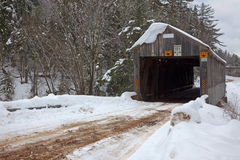 Covered Bridge in Winter. A covered bridge in winter surrounded by snow Royalty Free Stock Photography