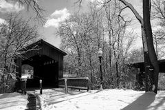 Covered Bridge in Winter. Covered bridge located in Ada Michigan royalty free stock photo