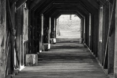 Free Covered Bridge With Stripes Of Afternoon Sunlight Royalty Free Stock Images - 90748399