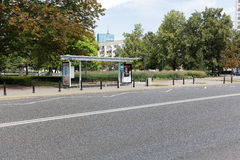 Covered bus stop in Warsaw. WARSAW, POLAND - AUGUST 05, 2016: General view towards a street and a covered bus stop where two billboards are placed. This bus stop stock photography