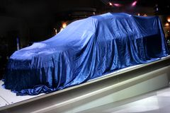 Covered Car. New Subaru Impreza prototype, 2006 WRC rally car, just few moments before it was unveiled, Frankfurt International Motor Show Royalty Free Stock Photos