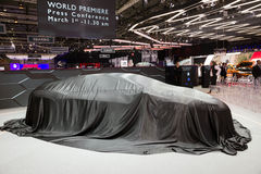 Covered car. GENEVA, SWITZERLAND - MARCH 1, 2016: New model car still covered at the 86th International Geneva Royalty Free Stock Photos