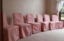 Covered chair in room Royalty Free Stock Photography