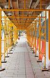 Covered constrcution walkway on sidewalk Stock Photo