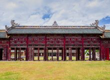 Covered corridor with red shutters and doors next to Can Thanh Palace, Hue forbidden city, Vietnam stock photo