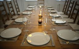 Covered dining table with wine glasses. Covered dining table with the wine glasses royalty free stock photography