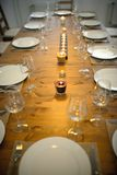 Covered dining table with wine glasses. Covered dining table with the wine glasses stock photos