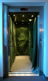 Covered elevator. Open steel elevator covered with green sheet Stock Images
