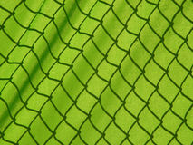 Covered fence. Shadow of a fence covered with a cloth on a tennis court Stock Photo