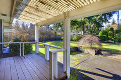 Covered front porch. With a nice view on the garden Stock Photography
