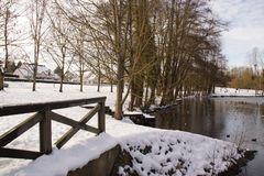 Covered in frost lake, snow and one bridge - France stock photo