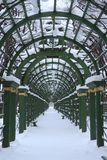 A covered gallery along the alley. In the park in winter Royalty Free Stock Photography