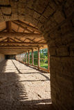 Covered gallery on ancient fortress Stock Photography