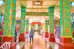 The covered gallery with market stalls in Kyauktawgyi Pagoda, Ma royalty free stock photo