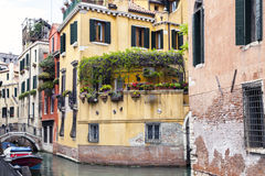 Covered gondolas on on a venetian Canal, Venice, Italy Royalty Free Stock Photos