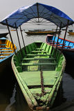 Covered green boat Stock Photography