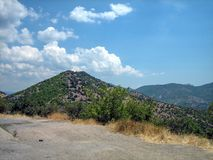 Covered with green bushes hills on a Sunny hot day royalty free stock photos
