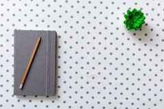 Covered grey diary at table Stock Photography